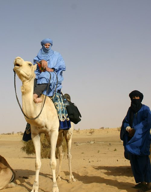 Mounted on camel in Sahara with Tuareg