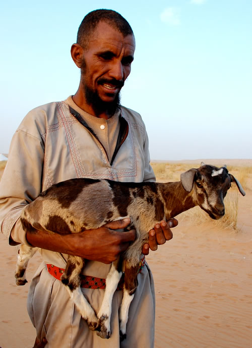 Man with Goat offering