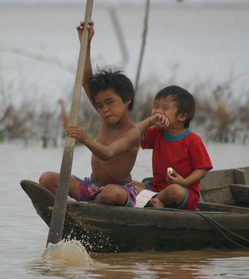 Paddling young children on the Mekong River