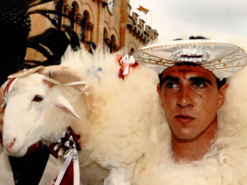 Man with a lamb at the Menorca festival