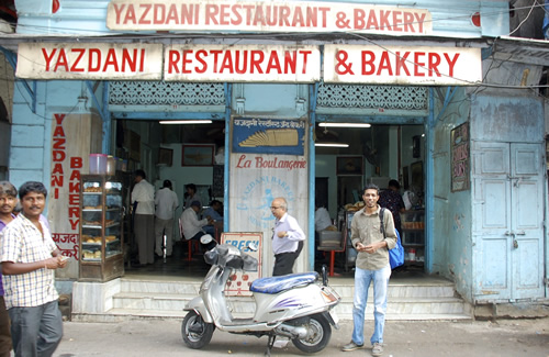 Rehan and scooter in front of legendary 'Yazdani Bakery'