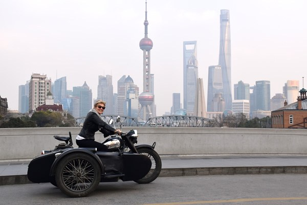The author cruising Shanghai driving a vintage motor cycle