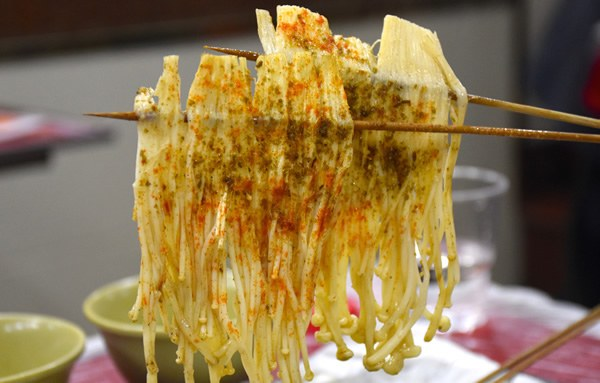 "Chop sticks with mushrooms and other foodon ""Untour Shanghai"""