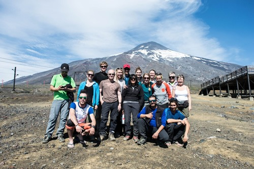 Small group travel: Team photo after scaling Volcano Villarrica in Chile