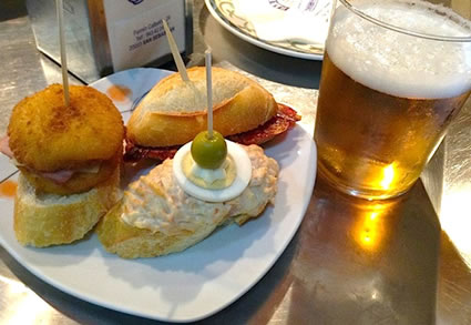 Typical variety of pintxos and a beer