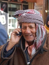 Man in Sfax Medina with cellphone