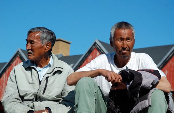 Local men relaxing in a fishing village in Greenland