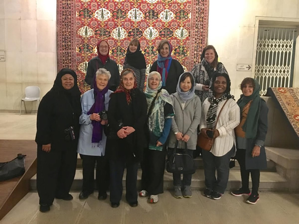 Women group in front of carpet