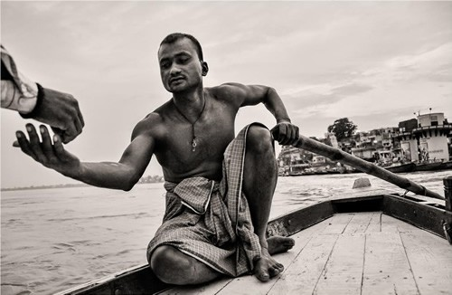 Boatman at dawn on Ganges, India