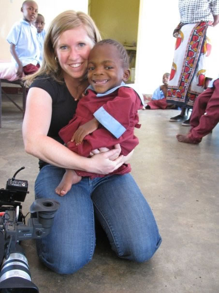 Holding a child in Kenya while doing a documentary