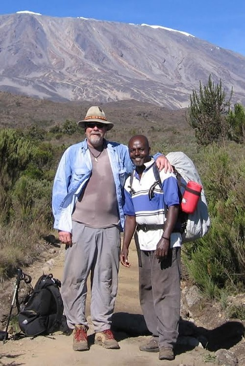 Author and Geoffrey on Kilimanjaro