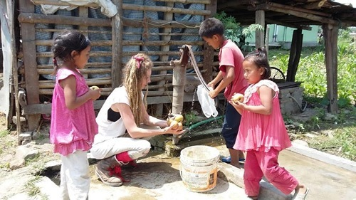Washing apples with Nepal children