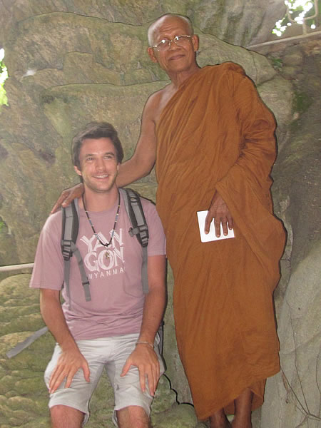 Monk with author in the cave.