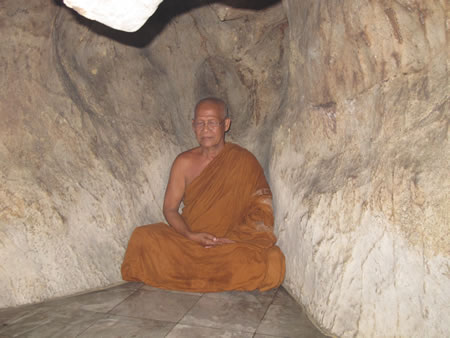 Monk in the cave in Thailand.