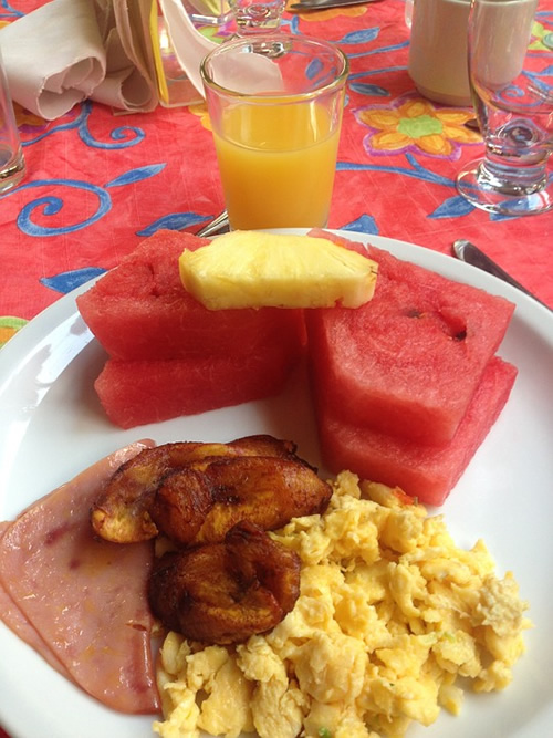 Costa Rican breakfast with eggs, plantains, and fruit