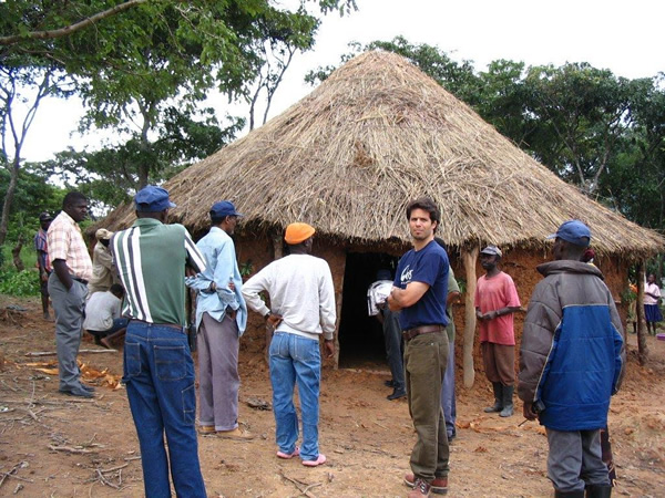 Juan Sheenan visiting one of the households he works with on the Catholic Relief Services' agriculture project in Angola