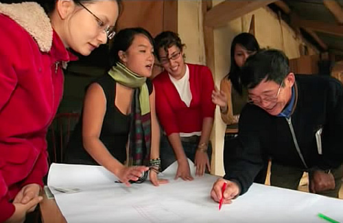 Vi Hoang at work with community leaders in Northern Vietnam