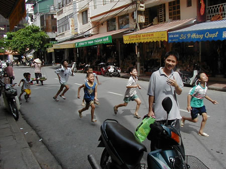 Kids running in Hanoi