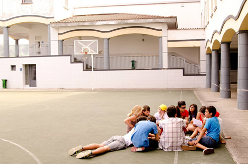 Students learning an English game in their physical education class
