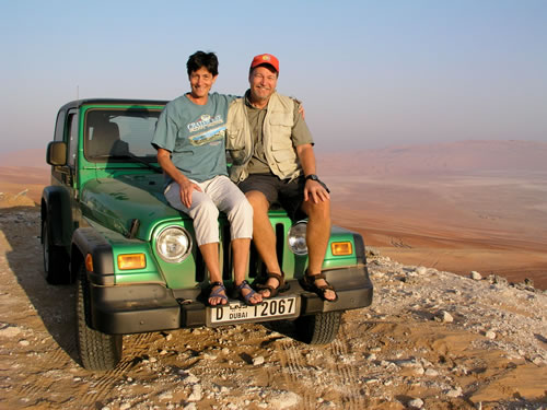 International teachers visiting sand dunes with 4x4