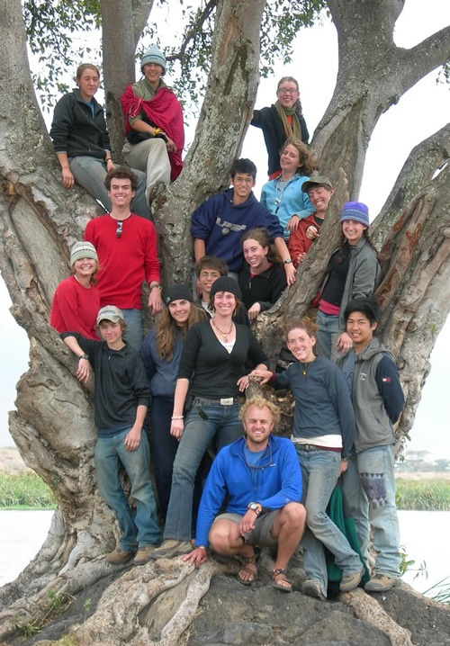 Leading a High School student group sitting on tree