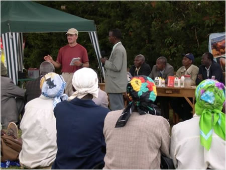 Volunteer training dairy producers in Kenya