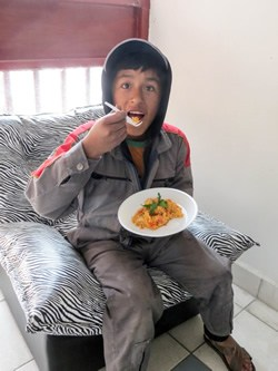 Bolivian child eating lunch