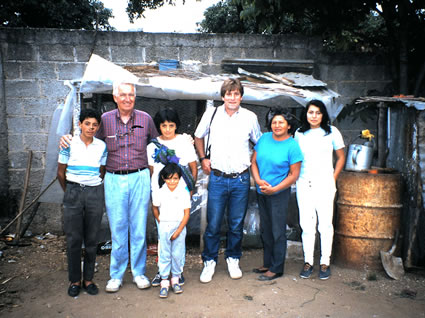 Peace Corps trainees with host family in Guatemala.