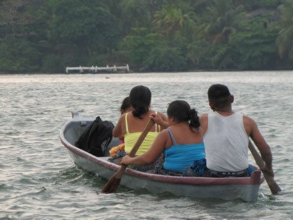 Locals on a boat in Rio Dolce