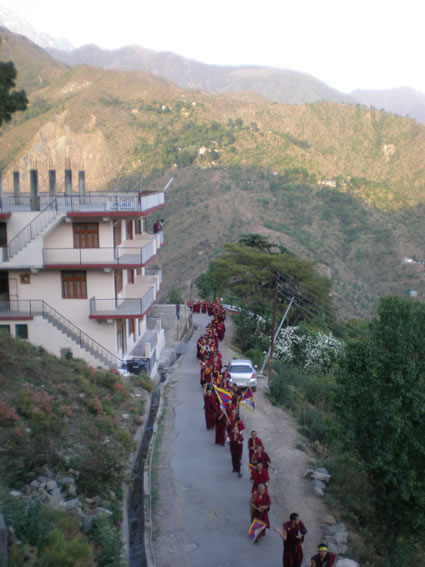 Monks pass by the school