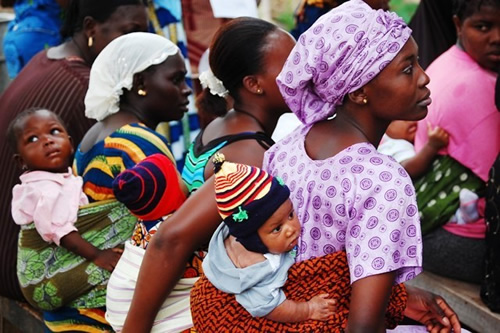 Mothers attend a health education seminar.