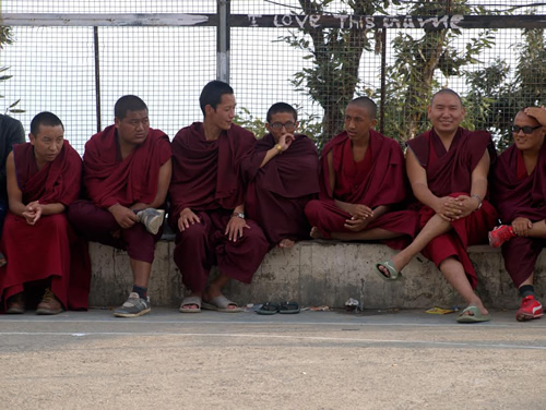 Tibetan monks watching basketball game