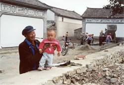 Granpa with son in China.