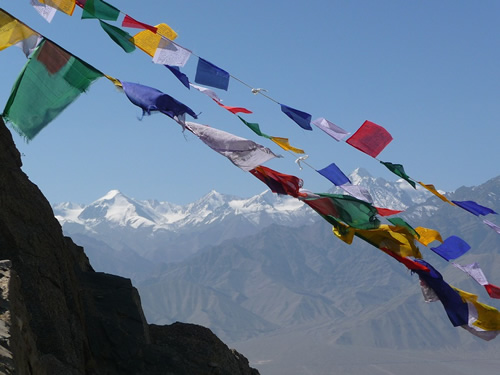Prayer flags in the wind in Ladakh in the Himalayas, India