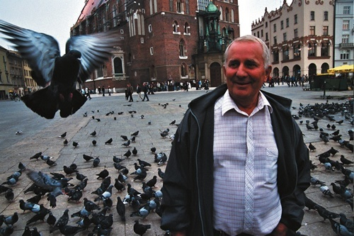Man with pigeons in Krakow