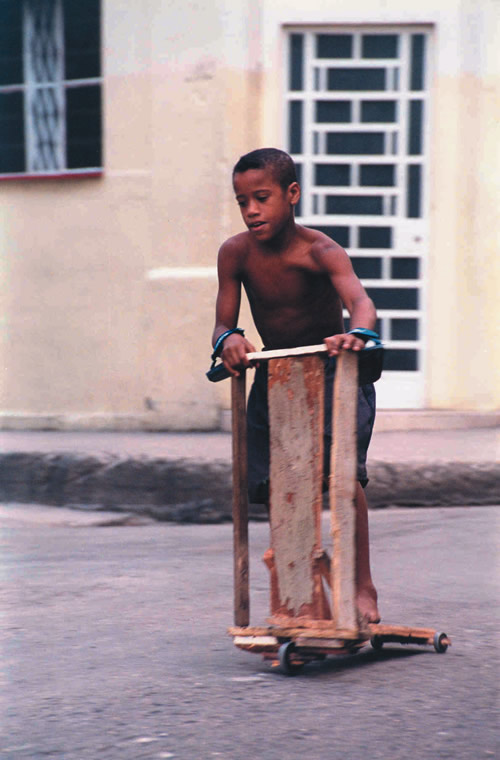 Photo of child riding home-made scooter in Cuba