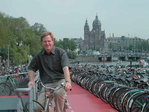 Rick Steves on a bike in Amsterdam