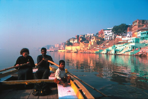 Teen rowing on the river Ganges in India