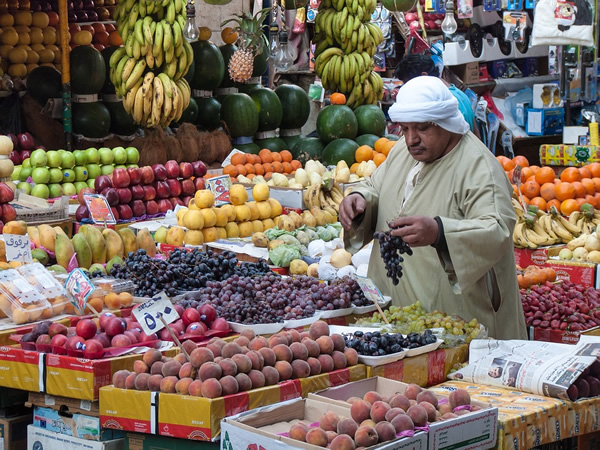 A fruit vendor with fresh produce in Cairo