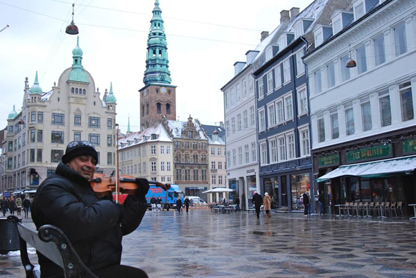 Gap year abroad. Man playing violin Copenhagen, Denmark