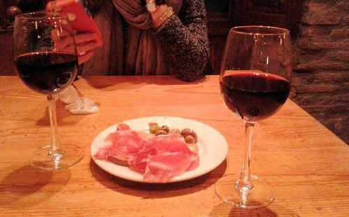 Tapas of jamon, olives, and red wine