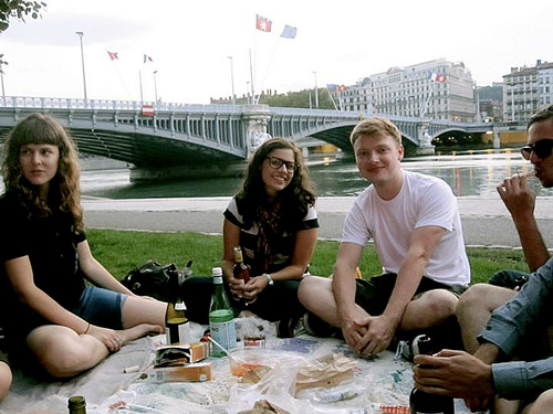 Picnic with friends near Rhone river in Lyon.