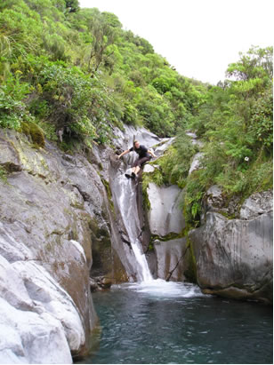 Jumping off a waterfall in New Zealand
