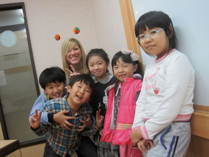 Jena with students in a classroom