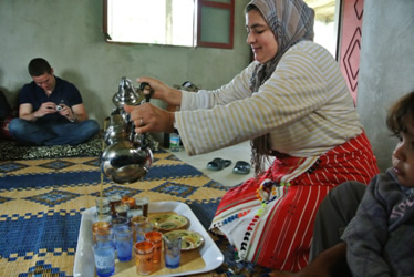 Serving Moroccan tea in village in Morocco