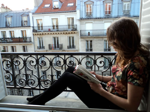 Reading a book in Paris