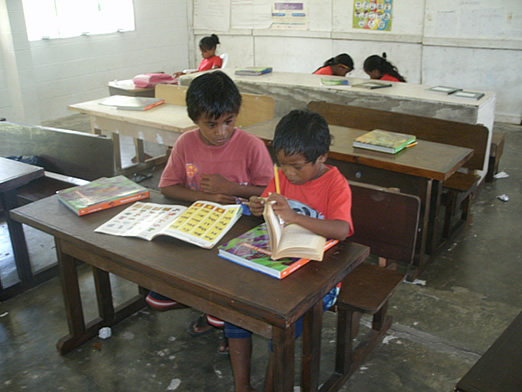 Volunteer teaching English to children in the Marshall Islands