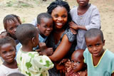 Akinmade with Children in Nigeria