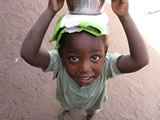 Girl with milk in Gambia